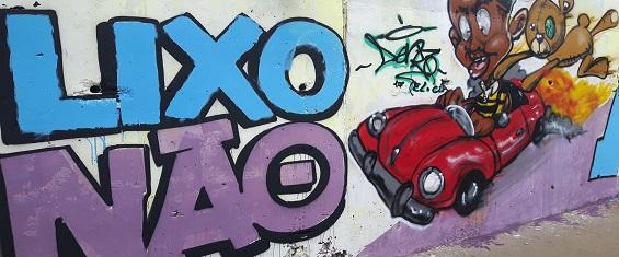Na imagem, grafite mostra campanha de conscientização com a frase Lixo não