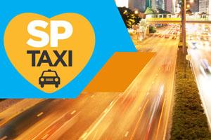 Imagem com logo do SPTaxi, ao fundo uma via da cidade de São Paulo